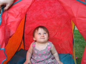 Girl sitting in a tent